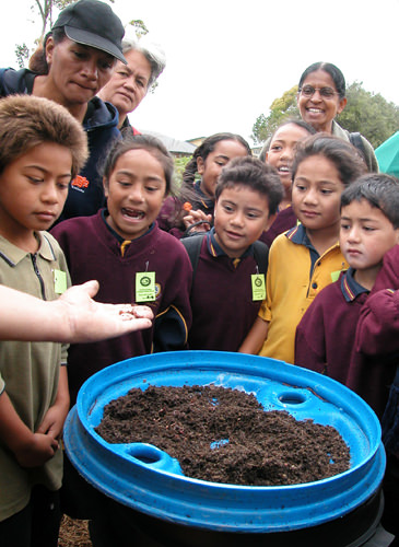 Maori children learning about worms
