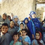 Afghanistan, 2003, Hazara village of Kharja Sarbour. Jude with women and children after meeting with village elders on seed saving.