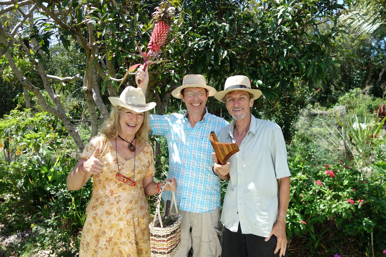 Jude Fanton, Jerry with pineapple he grew and Michel with panpipes during the filming of this segment